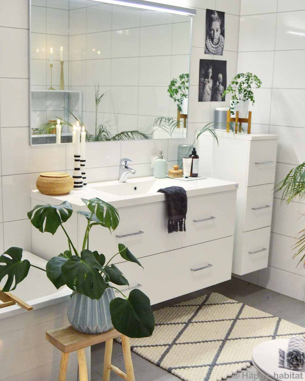 hand knotted white vanity and vase with green plants made by nepalian contemporary area rug