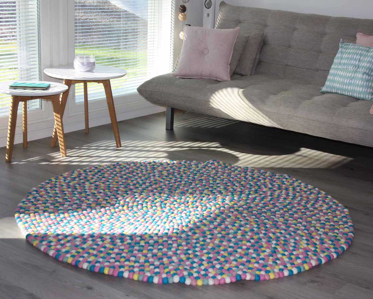 hand made gray sofa and round tables made by nepalian round felt ball rugs
