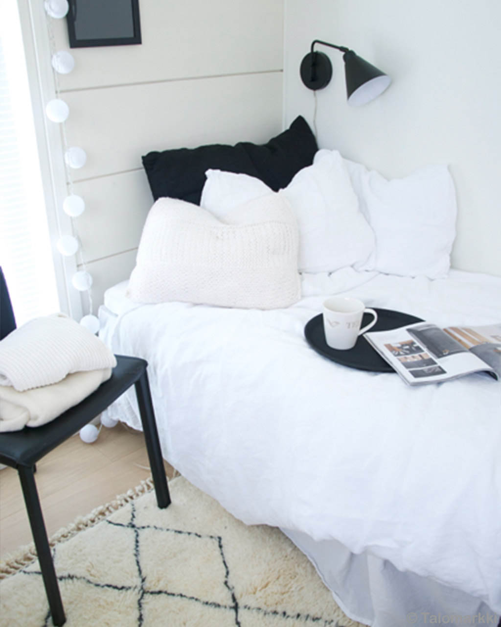 white bed and black chair african designer fluffy rugs