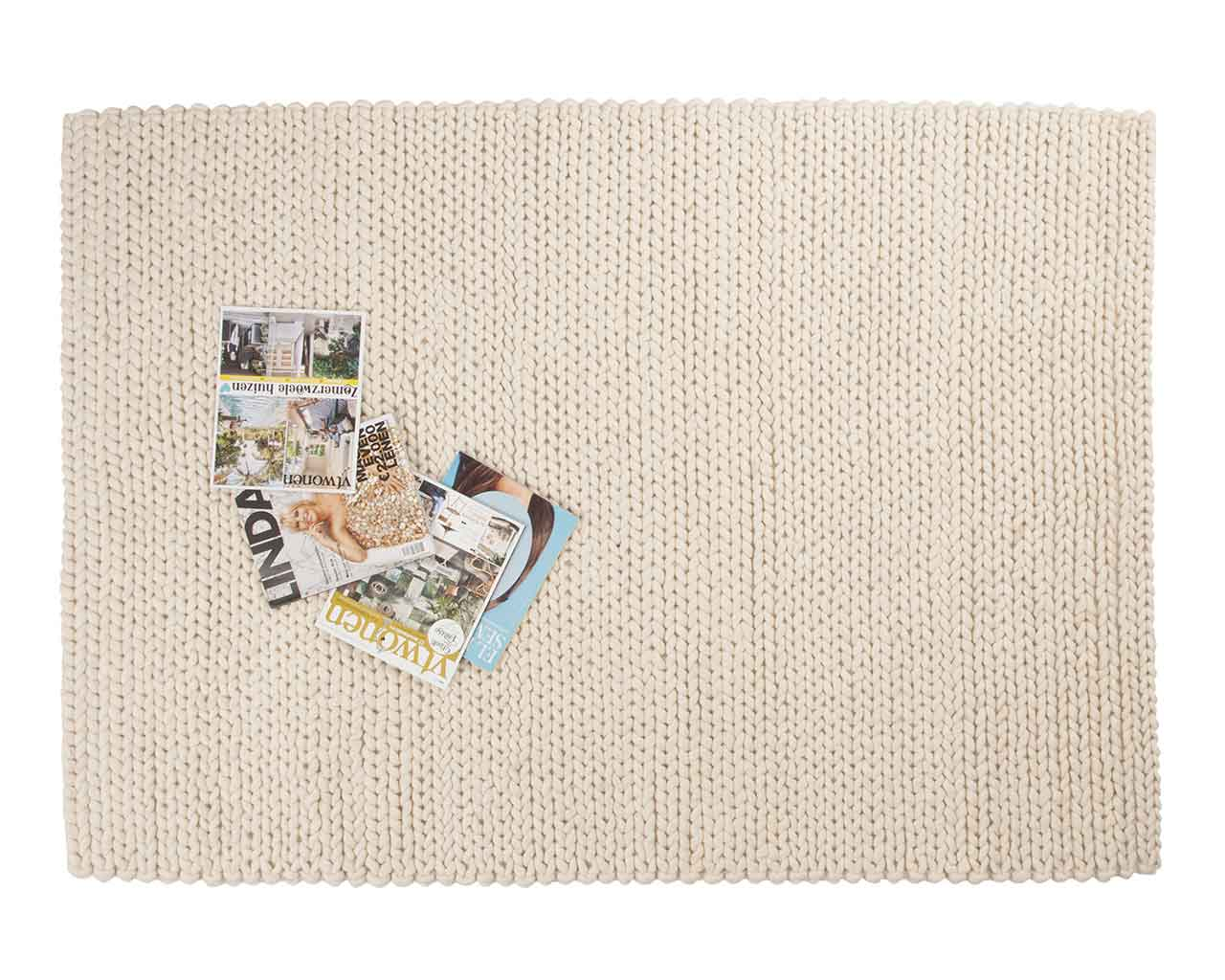 reading magazines soft woolen white carpet at home 1